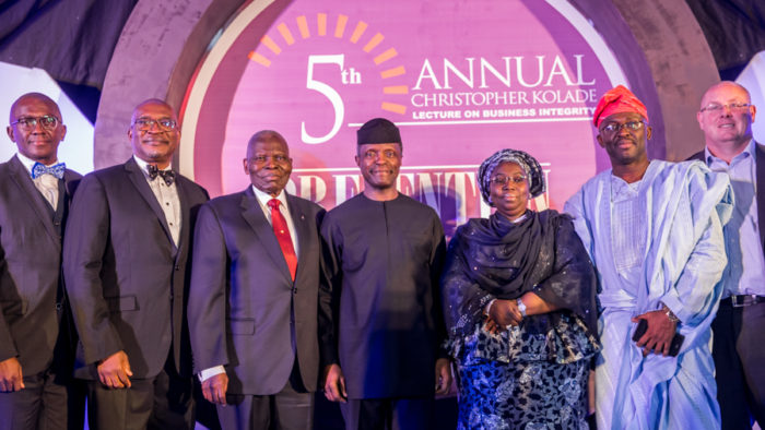 Osinbajo, middle, flanked by Dr. Christopher Kolade and deputy governor Oluranti Adebule