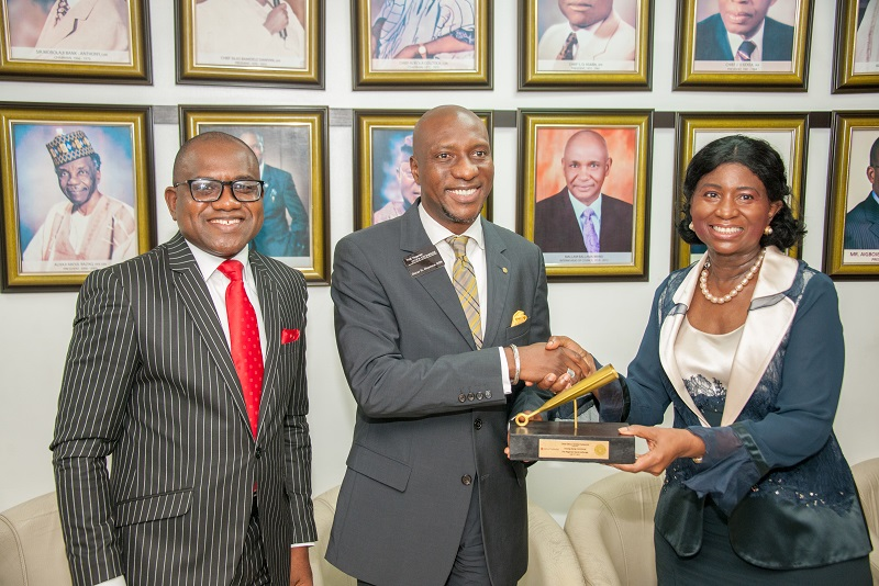 L-R: Chief (Mrs.) Eniola Fadayomi, Chairman (right); and Mr. Peter Ashade, Managing Director/CEO, Africa Prudential Plc (left); with Mr. Oscar Onyema, CEO, Nigerian Stock Exchange at the Closing Gong Ceremony held at the Exchange in Lagos, recently.