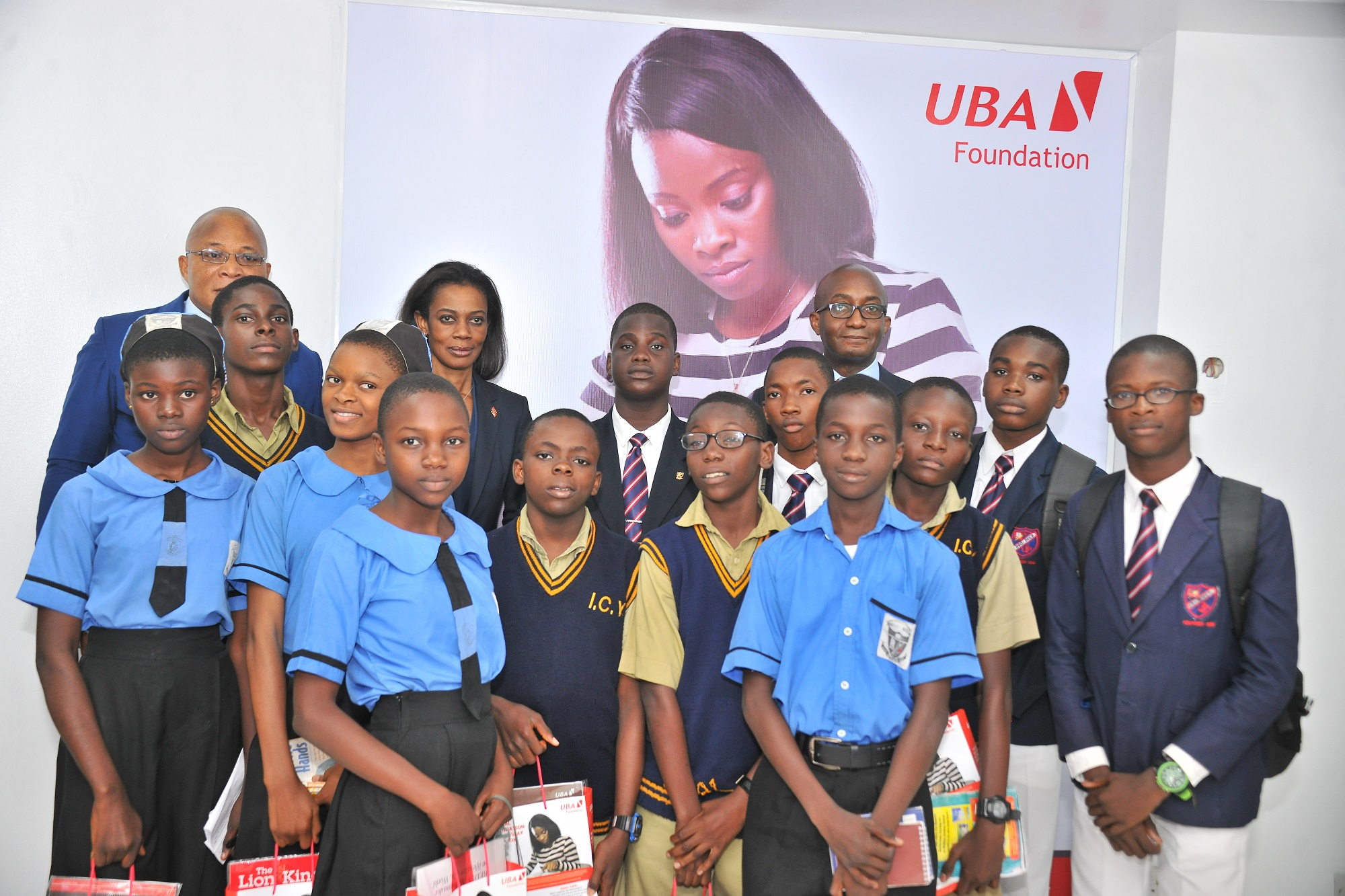 L-R Group Head,  External Relations, UBA Plc, Mr. Nasir Ramon; Director, Marketing and Corporate Relations and Chief Executive Officer, UBA Foundation, Mrs Bola Atta and Deputy CEO, Anglophone Africa, UBA Plc, Ebele Ogbue flanked by students from various schools in Lagos during the Launch of the 2017, UBA Foundation National Essay Competition held at the UBA House in , Lagos on Tuesday