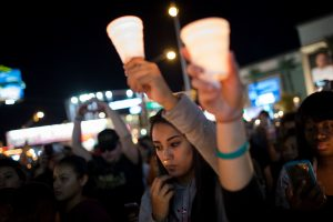 LAS VEGAS, NV - OCTOBER 2: Mourners attend a candlelight vigil at the corner of Sahara Avenue and Las Vegas Boulevard for the victims of Sunday night's mass shooting, October 2, 2017 in Las Vegas, Nevada. Late Sunday night, a lone gunman killed more than 50 people and injured more than 500 people after he opened fire on a large crowd at the Route 91 Harvest Festival, a three-day country music festival. The massacre is one of the deadliest mass shooting events in U.S. history. Drew Angerer/Getty Images/AFP