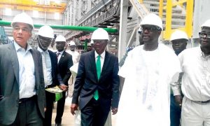 Mr Paul Gbededo,Group Managing Director, Flour Mill of Nigeria inspecting the Sugar Mill